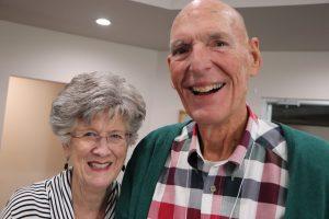 Family caregiver and care partner smiling